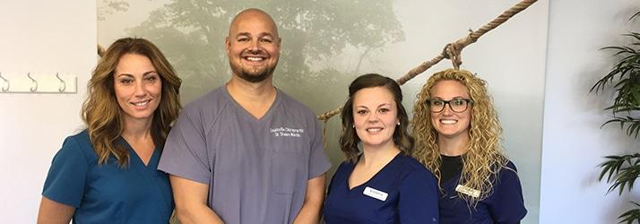 Chiropractor Louisville KY Shawn Martin With Staff